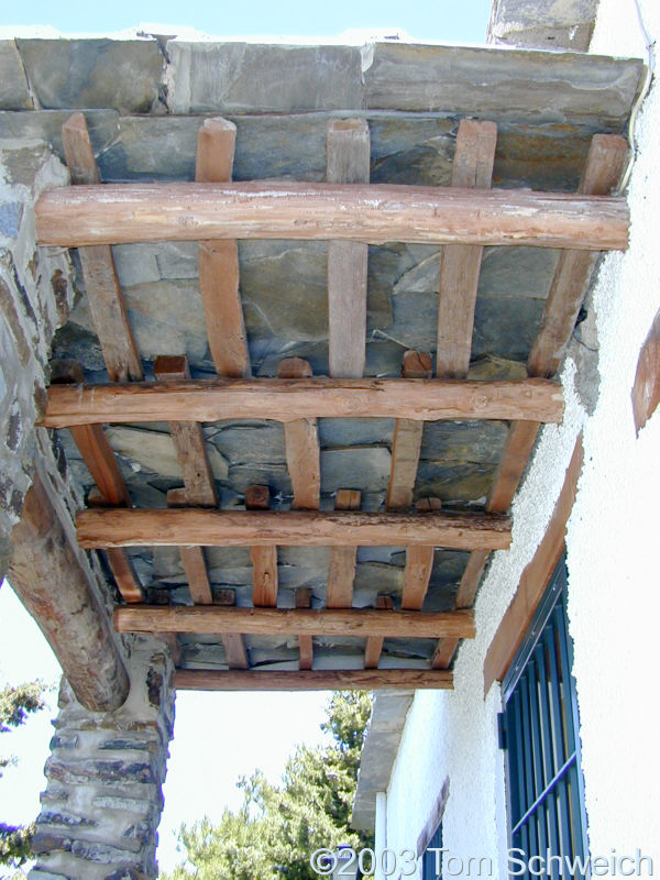 Ceiling construction with chestnut beams and slate.